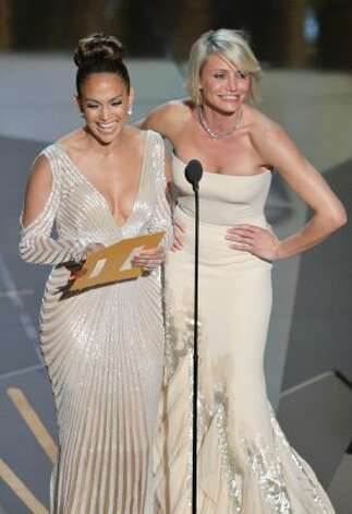 HOLLYWOOD, CA - FEBRUARY 26:  Presenters Jennifer Lopez (L) and Cameron Diaz speak onstage during the 84th Annual Academy Awards held at the Hollywood & Highland Center on February 26, 2012 in Ho
