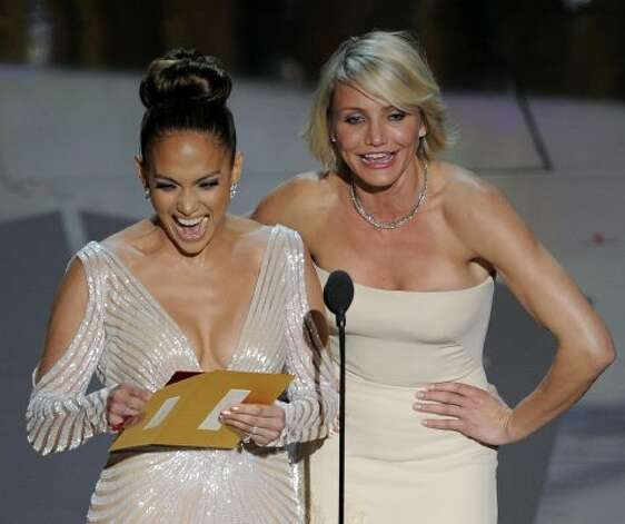Jennifer Lopez, left, and Cameron Diaz present an award during the 84th Academy Awards on Sunday, Feb. 26, 2012, in the Hollywood section of Los Angeles. (AP Photo/Mark J. Terrill) (AP)