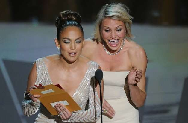 Cameron Dias And Jennifer Lopez present the Oscar for makeup onstage at the 84th Annual Academy Awards on February 26, 2012 in Hollywood, California. AFP PHOTO Robyn BECK (Photo credit should read ROBYN BECK/AFP/Getty Images) (ROBYN BECK / AFP/Getty Images)