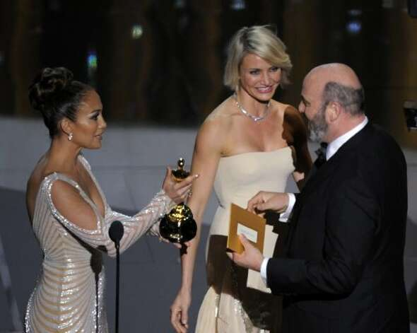 "Jennifer Lopez, left, and Cameron Diaz present Mark Bridges accepts the Oscar for best costume design for ""The Artist"" during the 84th Academy Awards on Sunday, Feb. 26, 2012, in the Hollywood section of Los Angeles. (AP Photo/Mark J. Terrill) (AP)"