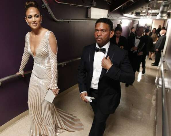 Jennifer Lopez walks backstage with Benny Medina during the 84th Academy Awards on Sunday, Feb. 26, 2012, in the Hollywood section of Los Angeles. (AP Photo/Chris Carlson) (AP)