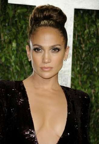 Jennifer Lopez arrives at the Vanity Fair Oscar party on Sunday, Feb. 26, 2012, in West Hollywood, Calif. (AP Photo/Evan Agostini) (AP)