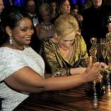 "Octavia Spencer, left, winner of  best supporting actress in ""The Help"" and Meryl Streep winner of best actress in ""The Iron Lady"" at the Governors Ball following the 84th Academy Awards on Sunday, Feb. 26, 2012, in the Hollywood section of Los Angeles. (AP Photo/Chris Pizzello)"