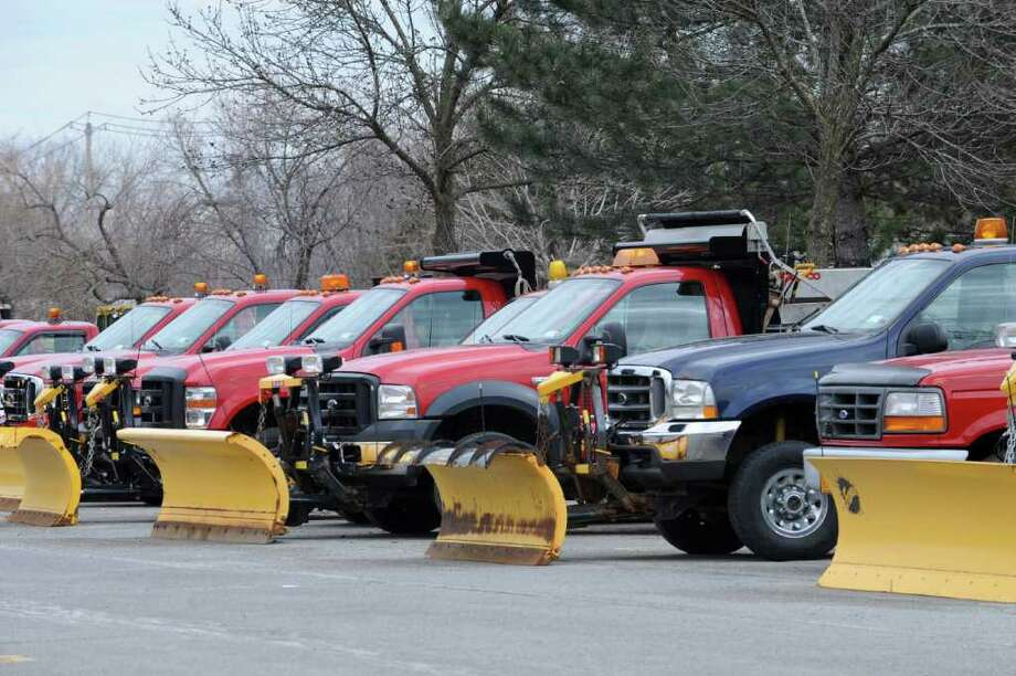 Plow trucks are lined up in a parking lot behind Colonie Center on Monday, Feb. 27, 2012 in Colonie, N.Y. Snow is predicted for the Capital Region later this week. (Lori Van Buren / Times Union) Photo: Lori Van Buren