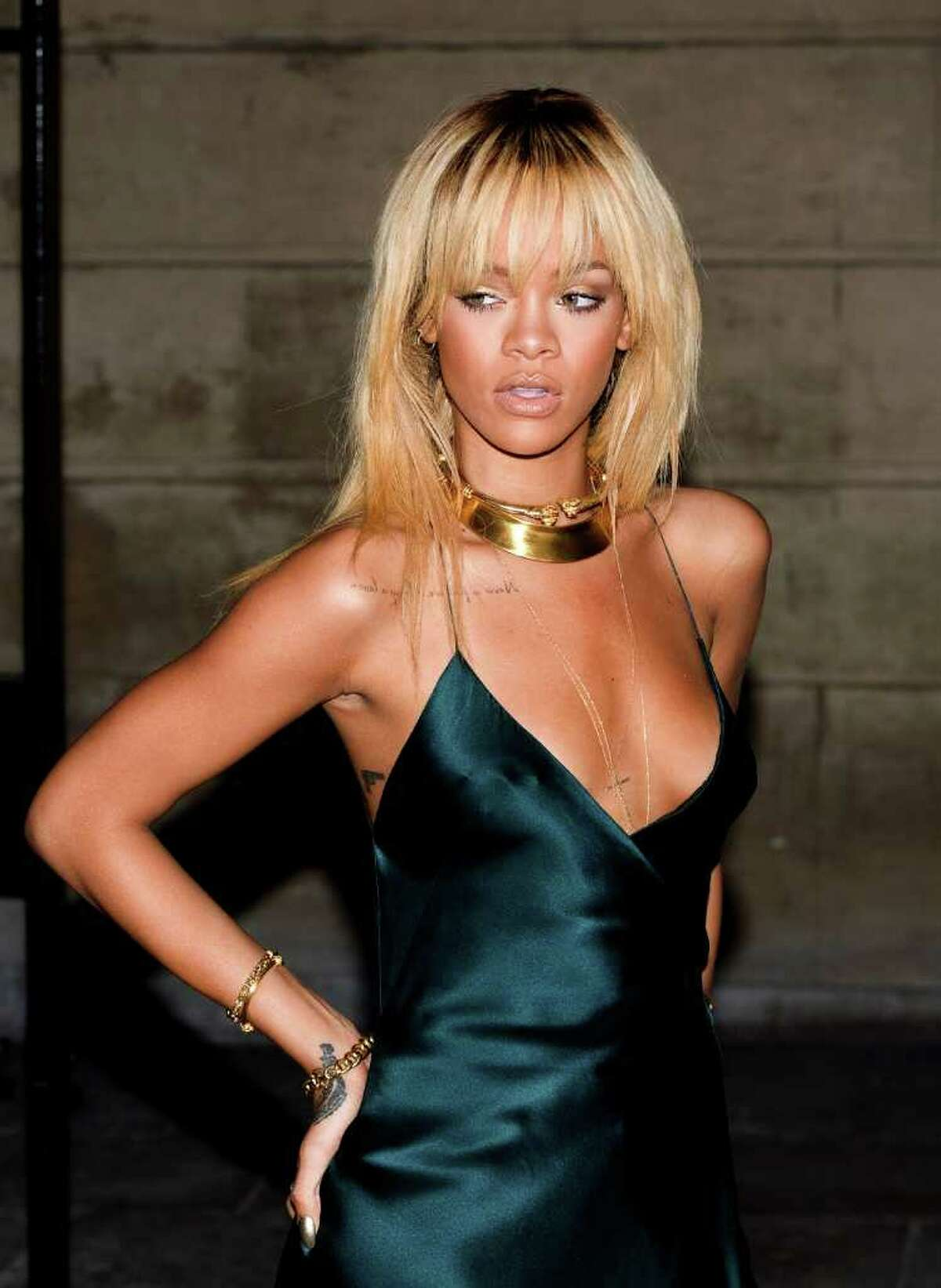 LONDON - FEBRUARY 18: Rihanna arrives for the Stella McCartney Special Presentation at 13 North Audley Street during London Fashion Week Autumn/Winter 2012 on February 18, 2012 in London, England. (Photo by Samir Hussein/Getty Images)