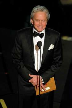 Michael Douglas presents an award during the 84th Academy Awards on Sunday, Feb. 26, 2012, in the Hollywood section of Los Angeles. (AP Photo/Mark J. Terrill) Photo: Mark J. Terrill