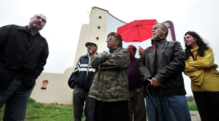 Ramon Vasquez, left, speaks at a protest concerning the City of San Antonio's plan to recreate the historic marquee at the old Mission Drive-In.  With him, left to right, are other residents and south side artists, Chista Cantu, Victor San Miguel, Jesse Trevino, and Elizabeth Rodriguez. Photo: BOB OWEN, San Antonio Express-News / © 2012 San Antonio Express-News