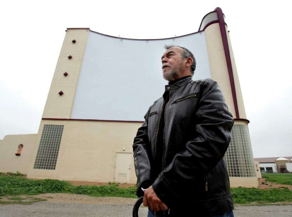 South Side residents and artists, including Jesse Trevino, gather at the old Mission Drive In to protest the plan by the City of San Antonio to recreate the historic marquee at the drive in. Monday, Feb. 27, 2012. Bob Owen/Express-News