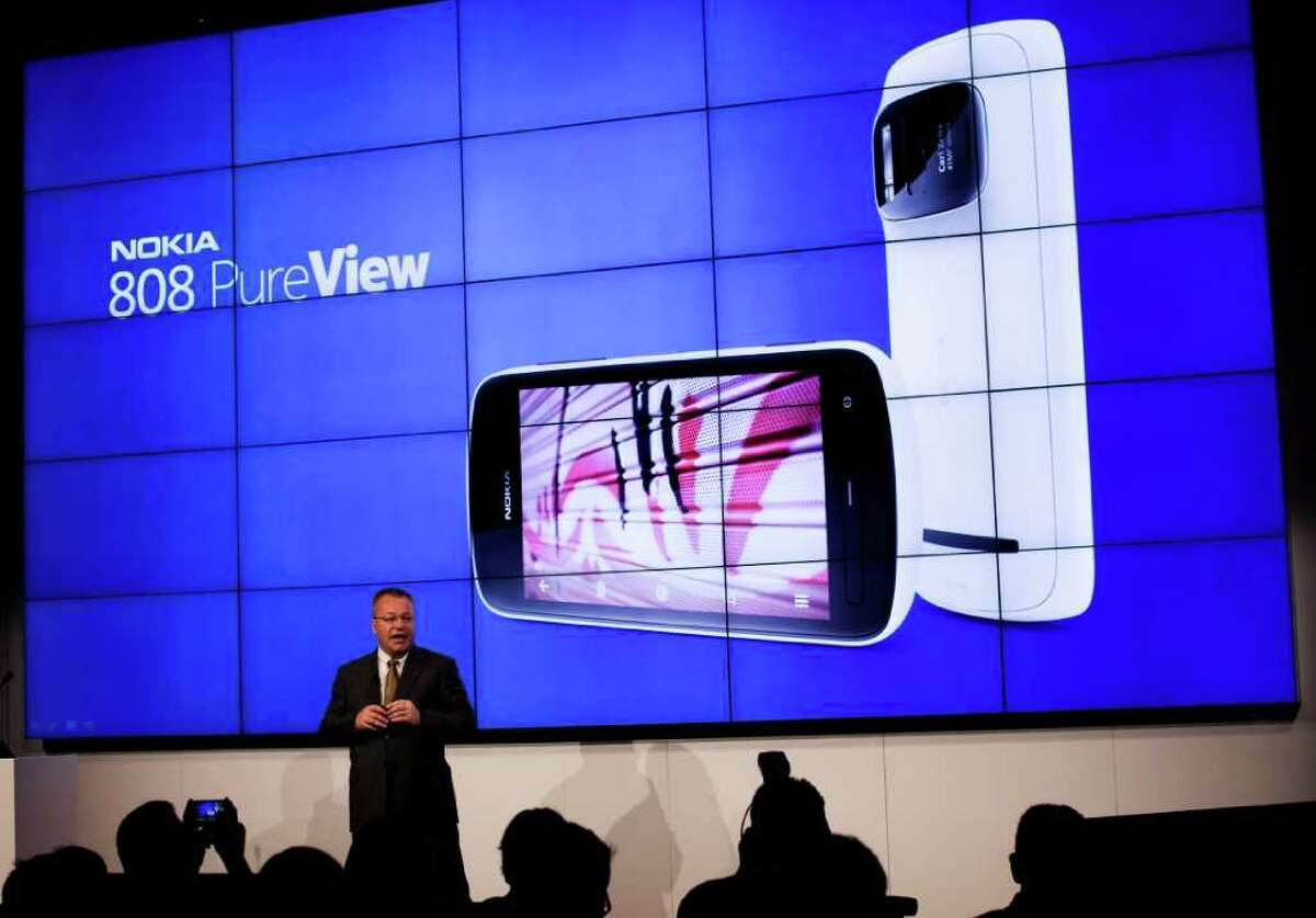 The chief executive officer of Nokia Corporation Stephen Elop, anounces a new model of his mobile phone company during a press conference at the Mobile World Congress in Barcelona, Spain, Monday, Feb. 27, 2012. Struggling cell phone maker Nokia Corp. has unveiled two new handsets that it hopes will revive its fortunes at the start of the world's largest mobile phone trade show on Monday. (AP Photo/Emilio Morenatti)