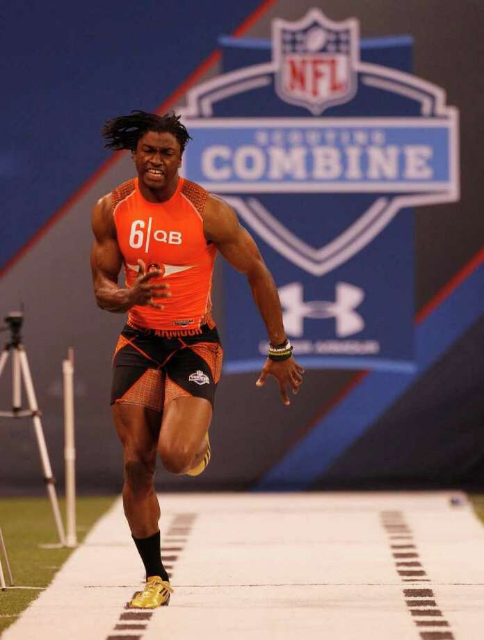Baylor quarterback Robert Griffin III runs a drill at the NFL football scouting combine in Indianapolis on Saturday, Feb. 25, 2012. Photo: AP