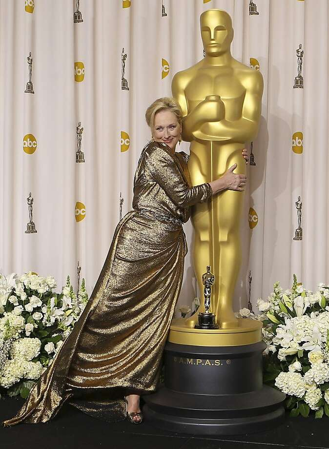 """He's all mine:For someone who won best actress for """"The Iron Lady,"""" Meryl Streep sure seems to like gold a lot. Photo: Joel Ryan, Associated Press"""