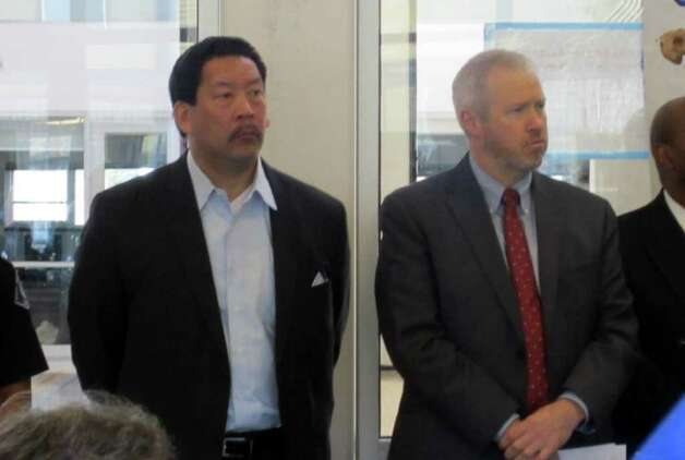 City Councilman Bruce Harrell, left, and Seattle Mayor Mike McGinn at a Feb. 27, 2012, press briefing about a rash of gun violence. Photo: Casey McNerthney/seattlepi.com