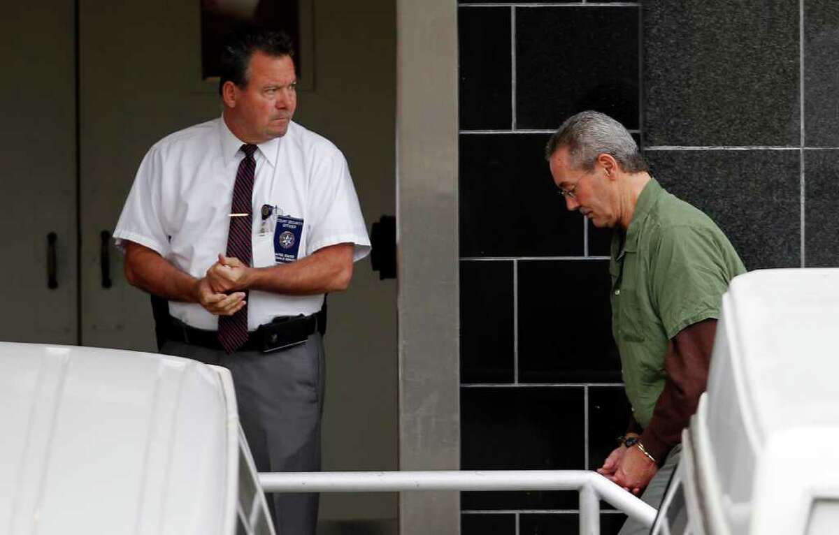 R. Allen Stanford, right, arrives at federal court in Houston on Monday. Stanford, 61, has been on trial on charges he led an investment fraud scheme.
