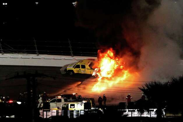 ...been halted by a fiery explosion caused when Juan Pablo Montoya slamm.