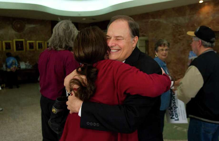 Nick Lampson embraces supporter Mandy Albritton of Houston after announcing his candidacy for the newly redrawn 14th congressional district seat, which has been represented for the last 24 years by Rep. Ron Paul. Photo: Brett Coomer / © 2012 Houston Chronicle