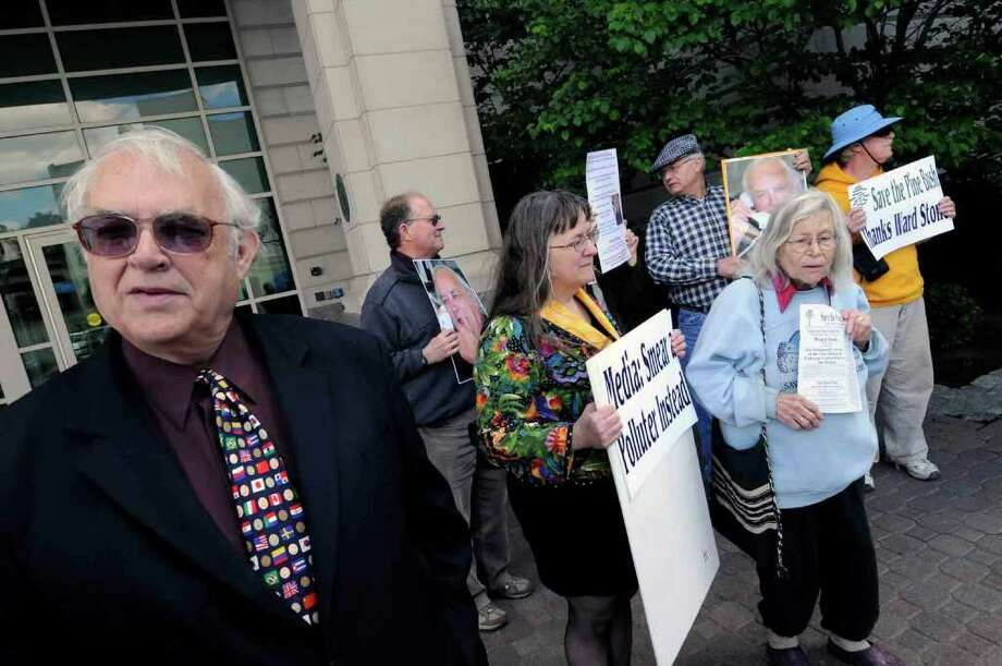 Former DEC wildlife pathologist Ward Stone, left, with supporters, protest at the New York State Department of Environmental Conservation building in Albany, N.Y., May 14, 2010. (Michael P. Farrell / Times Union) Photo: MICHAEL P. FARRELL / 00008748A