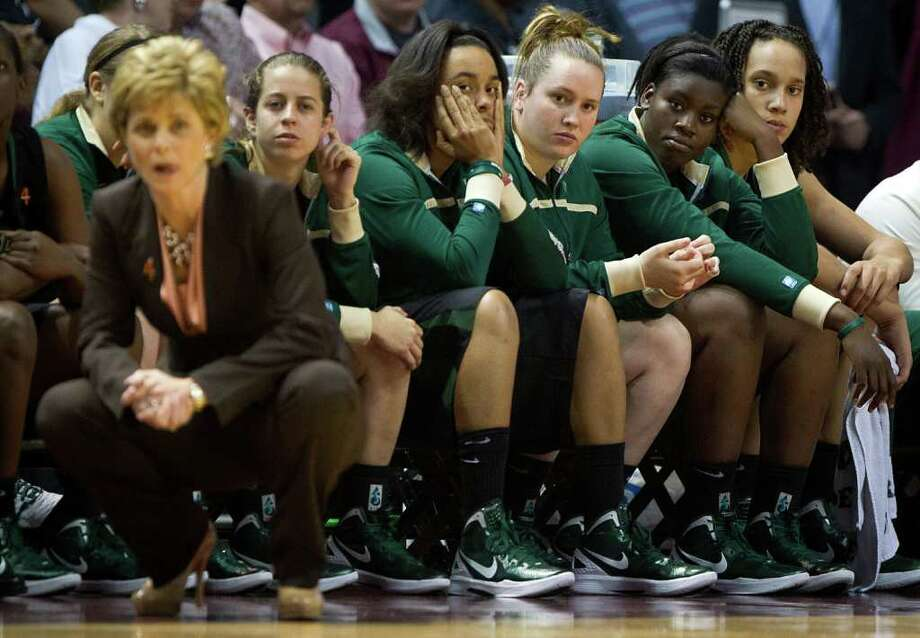 Baylor center Brittney Griner, far right, sits out due to foul trouble against Texas A&M during the first half of a NCAA women's basketball game at Reed Arena on Monday, Feb. 27, 2012, in College Station. Griner played 29 minutes, but scored 25 points. Photo: Smiley N. Pool, Houston Chronicle / © 2012  Houston Chronicle