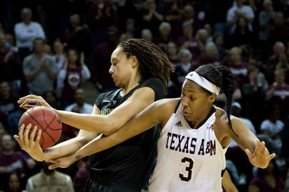 Baylor center Brittney Griner (42) takes a rebound away from Texas A&M center Kelsey Bone (3) during the second half of a NCAA women's basketball game at Reed Arena on Monday, Feb. 27, 2012, in College Station. Photo: Smiley N. Pool, Houston Chronicle / © 2012  Houston Chronicle