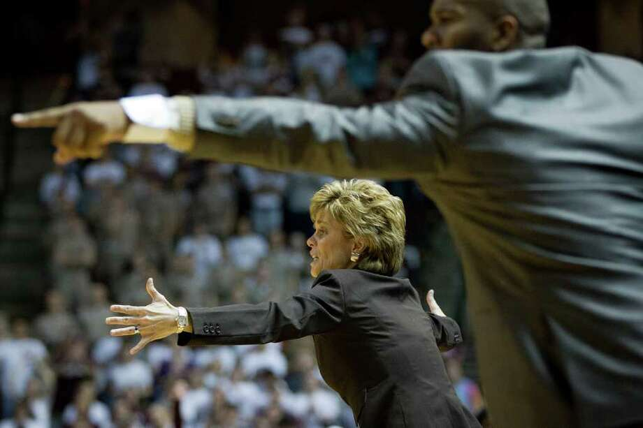 Baylor head coach Kim Mulkey directs her team against Texas A&M during the second half of a NCAA women's basketball game at Reed Arena on Monday, Feb. 27, 2012, in College Station. Photo: Smiley N. Pool, Houston Chronicle / © 2012  Houston Chronicle