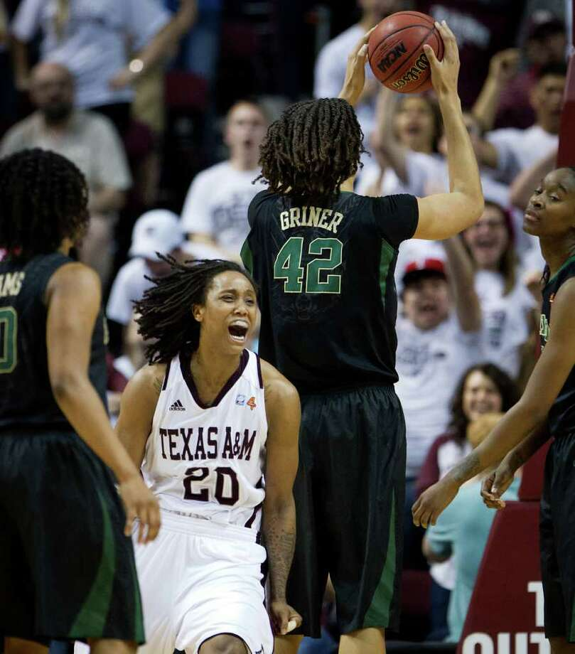 Texas A&M guard Tyra White (20) celebrates after scoring against Baylor center Brittney Griner (42) to tie the game during the second half of a NCAA women's basketball game at Reed Arena on Monday, Feb. 27, 2012, in College Station. Photo: Smiley N. Pool, Houston Chronicle / © 2012  Houston Chronicle