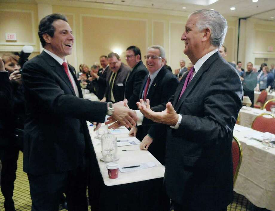 Governor Andrew Cuomo, left, shakes hands with Albany Mayor Jerry Jennings at the New York State Conference of Mayors and Municipal Officials at the Hotel Albany on Monday, Feb. 27, 2012 in Albany, NY.  (Paul Buckowski / Times Union) Photo: Paul Buckowski