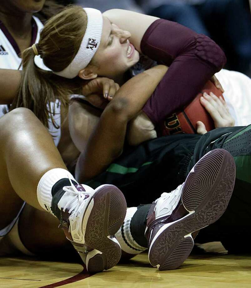 Texas A&M forward Kelsey Assarian (40) tries to wrestle the ball away from Baylor guard Odyssey Sims during the second half of a NCAA women's basketball game at Reed Arena on Monday, Feb. 27, 2012, in College Station. Photo: Smiley N. Pool, Houston Chronicle / © 2012  Houston Chronicle
