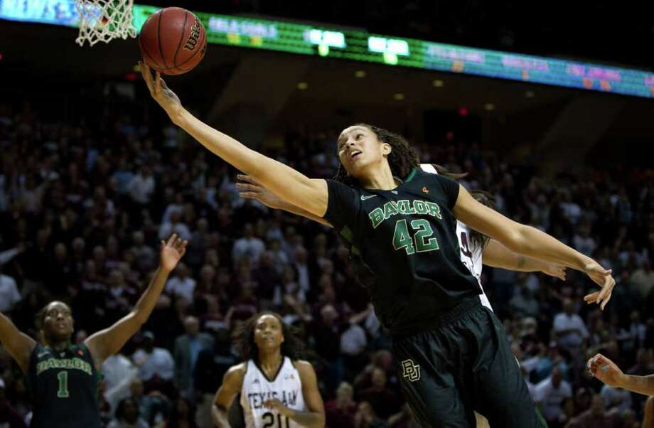 Baylor center Brittney Griner (42) stretches to grab a rebound against Texas A&M center Karla Gilbert (34) during the second half of a NCAA women's basketball game at Reed Arena on Monday, Feb. 27, 2012, in College Station. Photo: Smiley N. Pool, Houston Chronicle / © 2012  Houston Chronicle