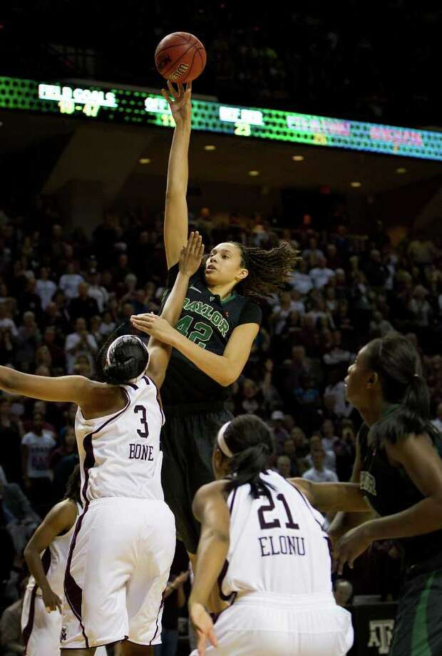 Baylor center Brittney Griner (42) towers over Texas A&M center Kelsey Bone (3) to score two of her 25 points for the game during the second half of a NCAA women's basketball game at Reed Arena on Monday, Feb. 27, 2012, in College Station. Photo: Smiley N. Pool, Houston Chronicle / © 2012  Houston Chronicle