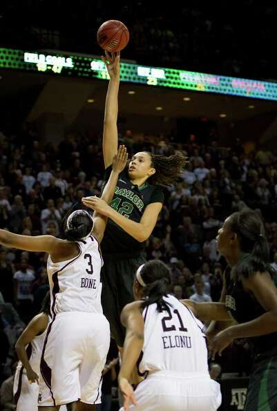 Baylor center Brittney Griner (42) towers over Texas A&M center Kelsey Bone (3) to score two of