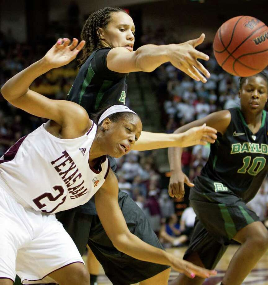 Baylor center Brittney Griner (42) knocks the ball away from Texas A&M forward Adaora Elonu (21) during the final minute of the Lady Bears 69-62 victory in a NCAA women's basketball game at Reed Arena on Monday, Feb. 27, 2012, in College Station. Photo: Smiley N. Pool, Houston Chronicle / © 2012  Houston Chronicle