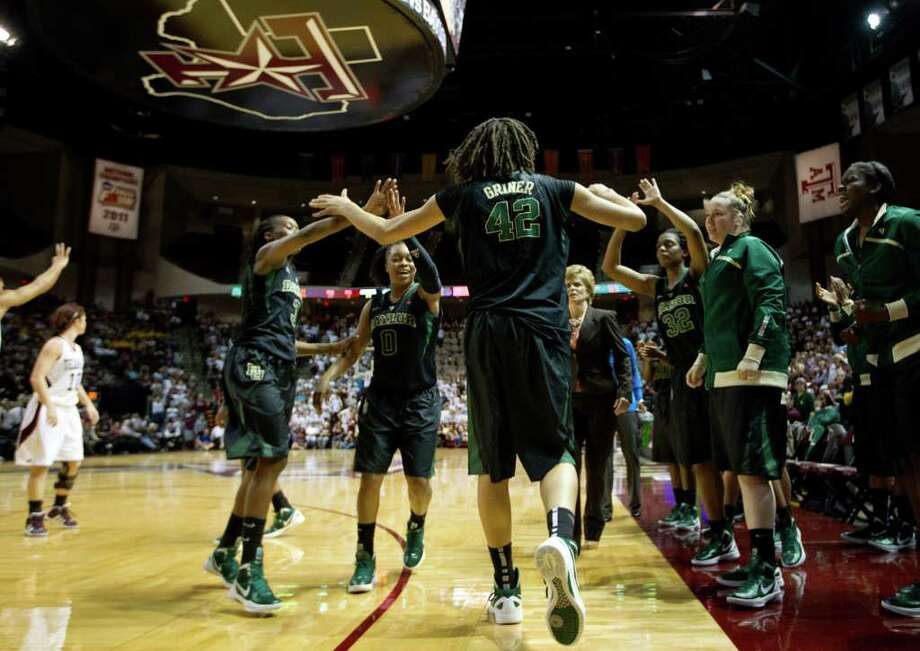 Baylor center Brittney Griner (42) celebrates with teammates during the final minute of the Lady Bears 69-62 victory over Texas A&M in a NCAA women's basketball game at Reed Arena on Monday, Feb. 27, 2012, in College Station. Photo: Smiley N. Pool, Houston Chronicle / © 2012  Houston Chronicle
