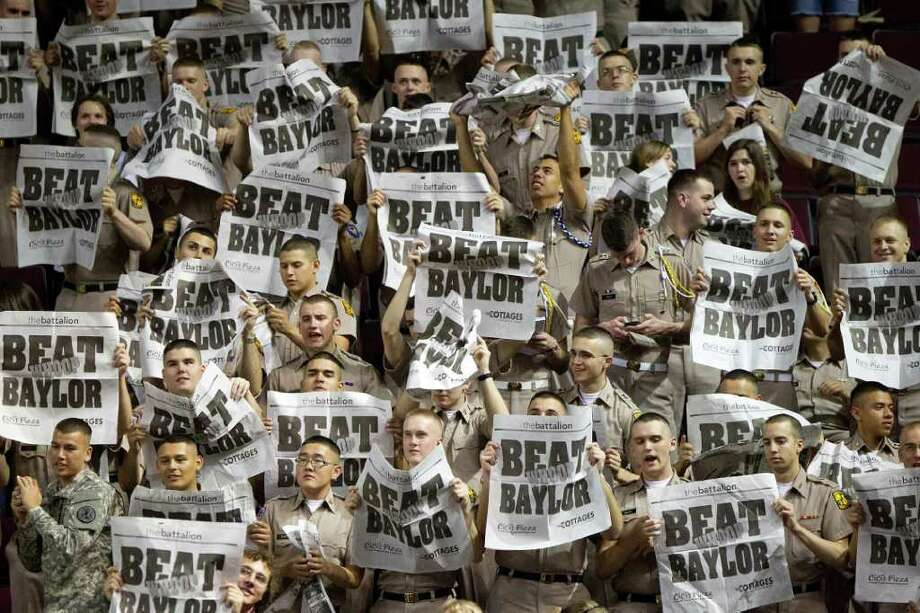 "Members of the Texas A&M Corps of Cadets hold up newsprint reading ""Beat Baylor"" before a NCAA women's basketball game at Reed Arena on Monday, Feb. 27, 2012, in College Station. Photo: Smiley N. Pool, Houston Chronicle / © 2012  Houston Chronicle"