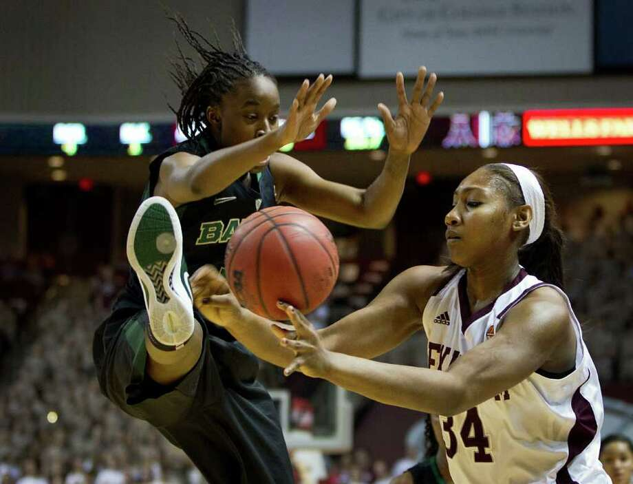 Baylor guard Jordan Madden (3) kicks the ball away from Texas A&M center Karla Gilbert (34) during the first half of a NCAA women's basketball game at Reed Arena on Monday, Feb. 27, 2012, in College Station. Photo: Smiley N. Pool, Houston Chronicle / © 2012  Houston Chronicle