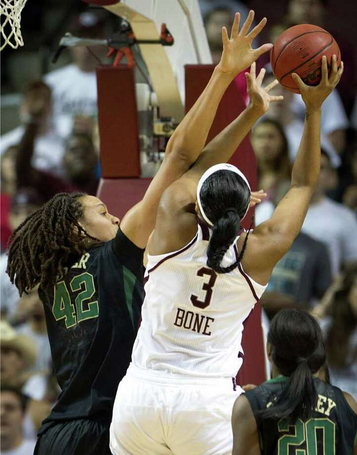 Baylor center Brittney Griner (42) picks up a foul as she tries to block a shot by Texas A&M center Kelsey Bone (3) during the first half of a NCAA women's basketball game at Reed Arena on Monday, Feb. 27, 2012, in College Station. Photo: Smiley N. Pool, Houston Chronicle / © 2012  Houston Chronicle