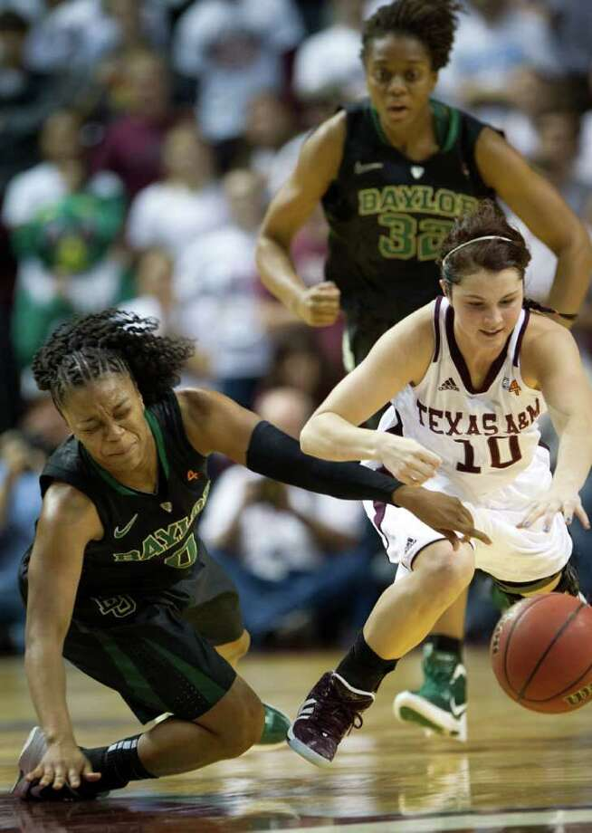 Baylor guard Odyssey Sims (0) scrambles for a loose ball against Texas A&M guard Alexia Standish (10) during the first half of a NCAA women's basketball game at Reed Arena on Monday, Feb. 27, 2012, in College Station. Photo: Smiley N. Pool, Houston Chronicle / © 2012  Houston Chronicle