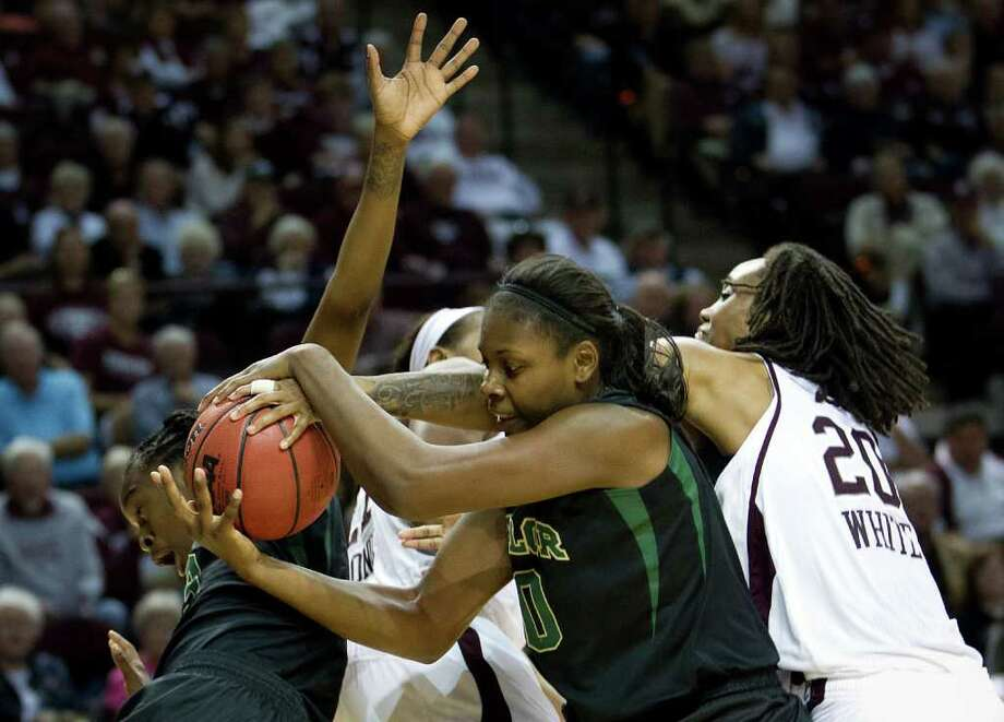 Texas A&M guard Tyra White (20) reaches in to try and take a ball away from Baylor forward/center Destiny Williams (10) as guard Jordan Madden (3) takes a tumble, at left, during the first half of a NCAA women's basketball game at Reed Arena on Monday, Feb. 27, 2012, in College Station. Photo: Smiley N. Pool, Houston Chronicle / © 2012  Houston Chronicle