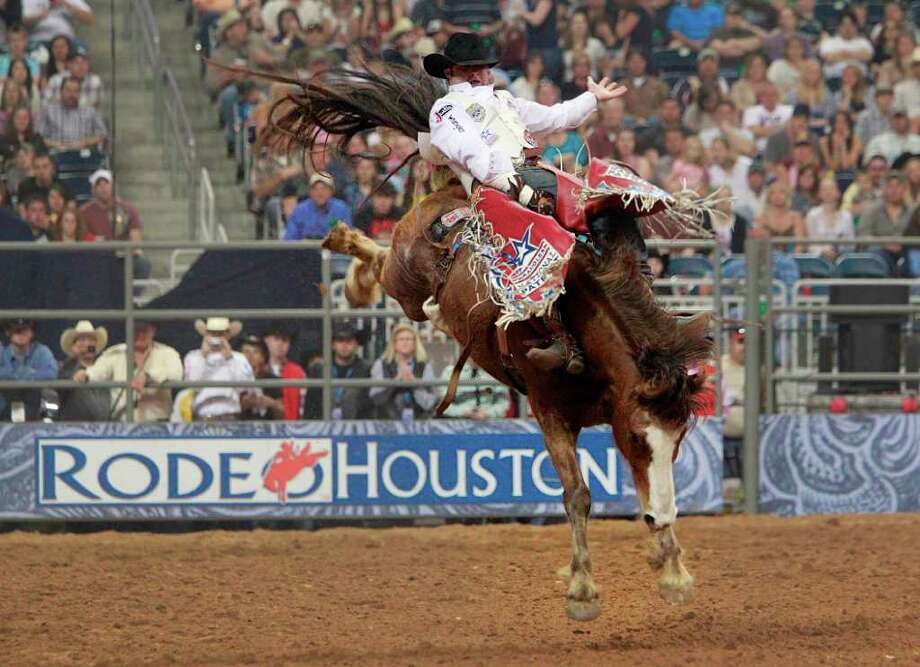 Kaycee Feild competes in the Bareback Riding finals of the Cinch Rodeo Houston Super Shootout: North America's Champions on the last day of the Houston Livestock Show and Rodeo at Reliant Center on Sunday, March 20, 2011, in Houston.( Mayra Beltran / Chronicle ) Photo: Mayra Beltran / Houston Chronicle