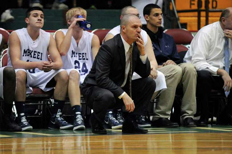 Mekeel Christian Academy basketball coach Chad Bowman on the sidelines during his team's 71-57 loss