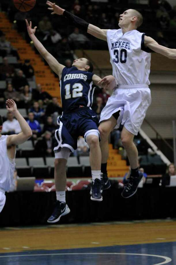 Cohoes player Elijah Newsome drives to the basket while  Mekeel Christian Academy's Collin Stewart, right, defends him during the second half of Cohoes  71-57 victory in a Section II Class B semifinal at the Glens Falls Civic Center on Monday night Feb. 27, 2012 in Glens Falls, N.Y. (Philip Kamrass / Times Union ) Photo: Philip Kamrass / 00016567A