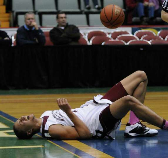 Watervliet's Jordan Gleason hits the floor after driving for a layup during the first half of their