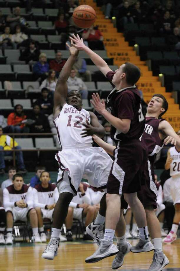 Watervliet's Antoine Johnson falls away as he puts up a shot during the second half of Watervliet's 75-40 victory over Stillwater in a Section II Class B semifinal at the Glens Falls Civic Center on Monday night Feb. 27, 2012 in Glens Falls, N.Y. (Philip Kamrass / Times Union ) Photo: Philip Kamrass / 00016567A