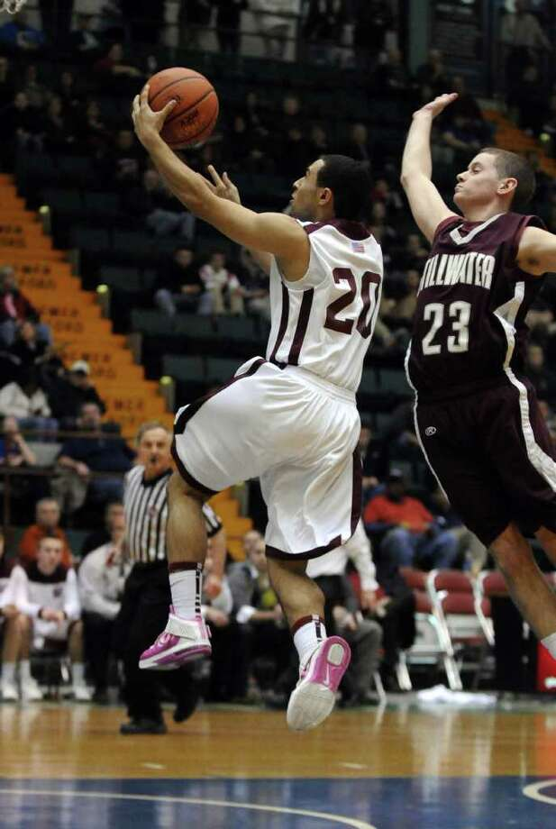 Watervliet's Jon Parker is about to be fouled by Stillwater's Evan Pafundi, right, as he puts up a shot during the second half of Watervliet's 75-40 victory in a Section II Class B semifinal at the Glens Falls Civic Center on Monday night Feb. 27, 2012 in Glens Falls, N.Y. (Philip Kamrass / Times Union ) Photo: Philip Kamrass / 00016567A