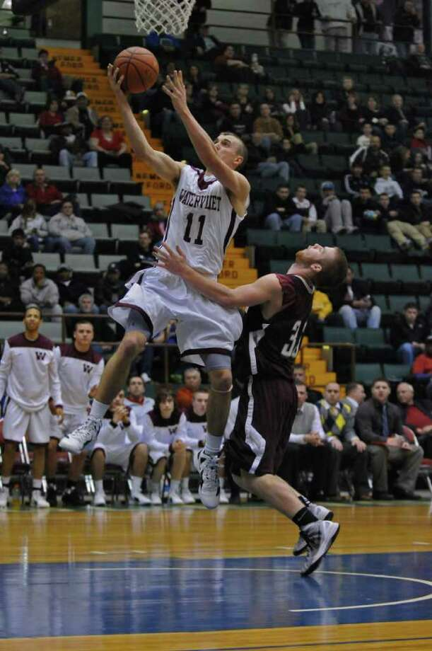 Watervliet's Griffin Kelly is defended by Stillwater's Shawn McNeil, right, during the second half of Watervliet's 75-40 victory in a Section II Class B semifinal at the Glens Falls Civic Center on Monday night Feb. 27, 2012 in Glens Falls, N.Y. (Philip Kamrass / Times Union ) Photo: Philip Kamrass / 00016567A