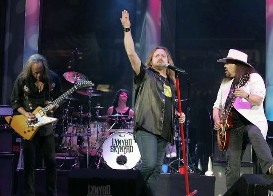 Southern rockers Lynyrd Skynyrd previously announced they would stop using the Confederate flag in performances, but they changed their minds after an outcry from fans. (James Nielsen / Houston Chronicle)