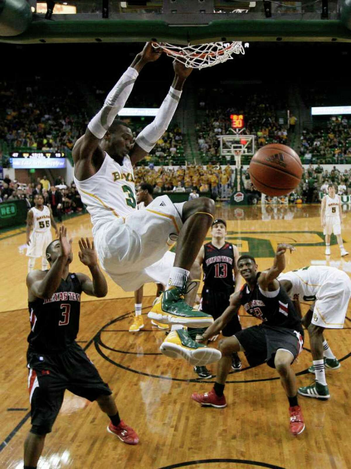 Baylor's Cory Jefferson (34) has an audience of Texas Tech defenders as he puts an exclamation point on the Bears' lopsided victory with a second-half dunk.