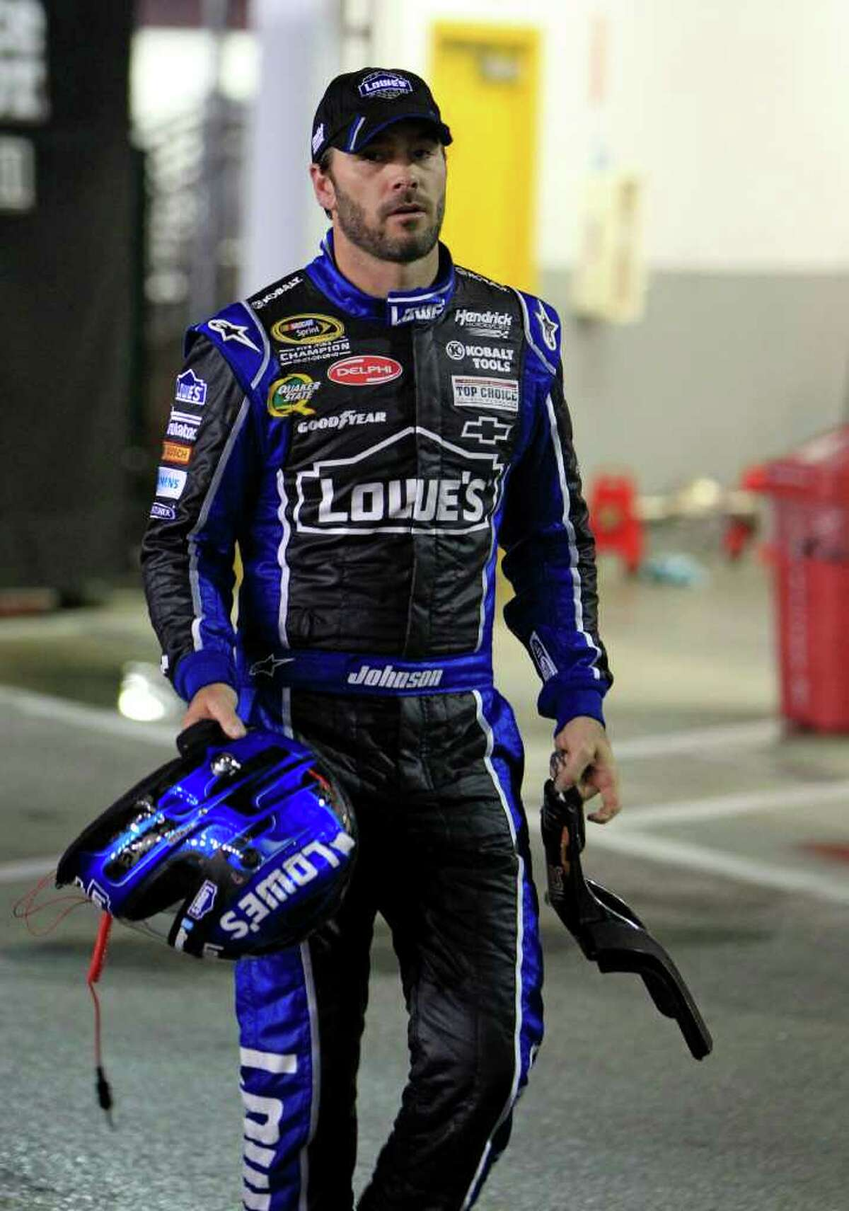 Jimmie Johnson walks to his hauler from the infield care center after he was involved in a crash on the second lap of the NASCAR Daytona 500 auto race at Daytona International Speedway in Daytona Beach, Fla., Monday, Feb. 27, 2012. (AP Photo/John Raoux)