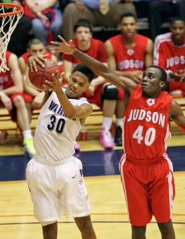 Warren's Jerell Ellis and Judson's Derrik Luster grab for a rebound during second half action of their Class 5A third-round playoff game on Monday, Feb. 27, 2012 at the UTSA Convocation Center. Warren won in overtime 64-61. Photo: EDWARD A. ORNELAS, San Antonio Express-News / © SAN ANTONIO EXPRESS-NEWS (NFS)