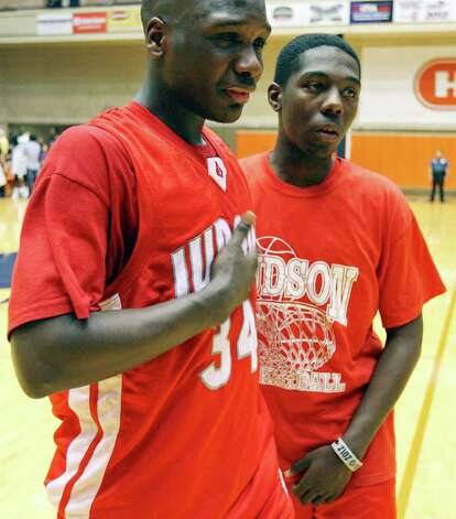Judson's Sheawn Bedford (from left) and Jamie Duncan walk off the court after their Class 5A third-round playoff game with Warren on Monday, Feb. 27, 2012 at the UTSA Convocation Center. Warren won in overtime 64-61. Photo: EDWARD A. ORNELAS, San Antonio Express-News / © SAN ANTONIO EXPRESS-NEWS (NFS)