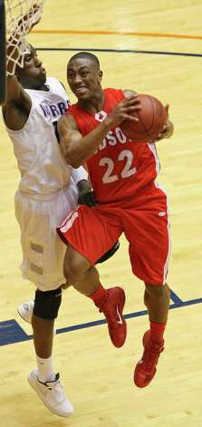 Judson's Jarveon Williams drives to the basket around Warren's Taurean Waller-Prince during first half action of their Class 5A third-round playoff game on Monday, Feb. 27, 2012 at the UTSA Convocation Center. Photo: EDWARD A. ORNELAS, San Antonio Express-News / © SAN ANTONIO EXPRESS-NEWS (NFS)