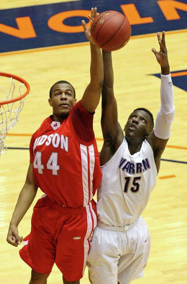 Judson's E.J. Hubbard and Warren's Taurean Waller-Prince grab for a rebound during first half action of their Class 5A third-round playoff game on Monday, Feb. 27, 2012 at the UTSA Convocation Center. Photo: EDWARD A. ORNELAS, San Antonio Express-News / © SAN ANTONIO EXPRESS-NEWS (NFS)